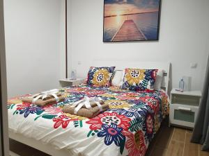 A bed or beds in a room at BRISAS DEL MAR APARTMENT, ONE STEP FROM THE SEA.