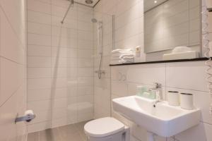 Ein Badezimmer in der Unterkunft Aquarius Hotel
