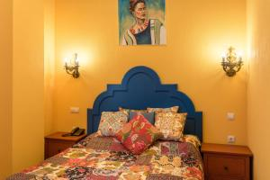A bed or beds in a room at Welcome House Boutique Hotel