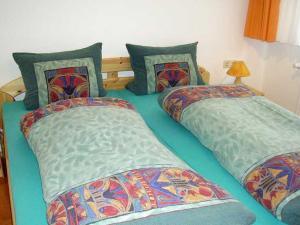 Ein Bett oder Betten in einem Zimmer der Unterkunft Äckerhof