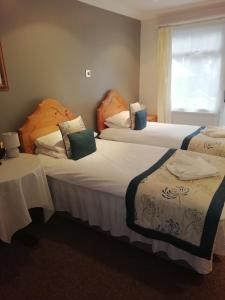 A bed or beds in a room at Eden Spa Hotel