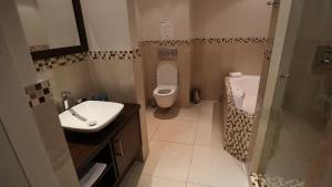 A bathroom at Lagoon Beach Hotel & Spa