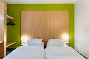 A bed or beds in a room at B&B Hôtel Béziers