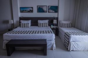 Cama ou camas em um quarto em Crocobeach Hotel