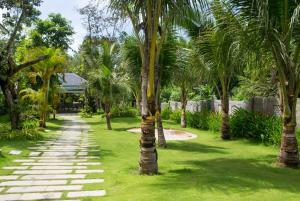 A garden outside Nadine Phu Quoc Resort & Spa