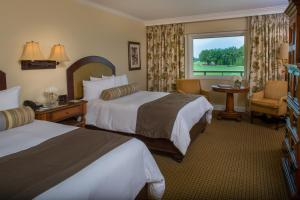 A bed or beds in a room at Arnold Palmer's Bay Hill Club & Lodge