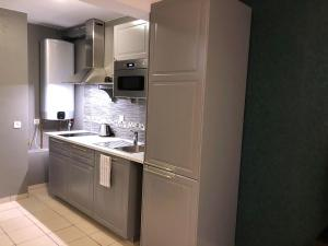 A kitchen or kitchenette at Apartment in Antwerp city centre