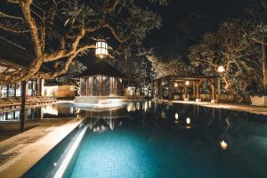 The swimming pool at or near Puri Santrian