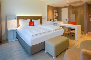 A bed or beds in a room at The Rilano Hotel Cleve City