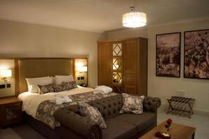 A bed or beds in a room at De Vere Cranage Estate