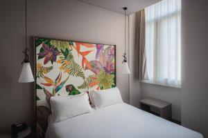 Letto o letti in una camera di Hotel San Giovanni Roma
