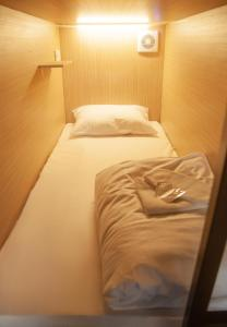 A bed or beds in a room at Capsule Hostels Rus-Kitay-gorod