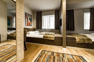 Krevet ili kreveti u jedinici u okviru objekta Belgrade Inn Garni Hotel