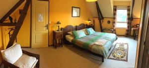 A bed or beds in a room at Les Petits Gallais