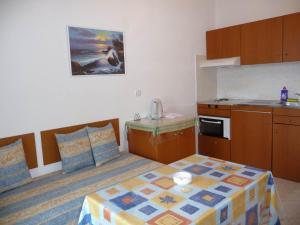 A kitchen or kitchenette at Irinoula Apartments