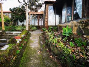 A garden outside Hotel os Moinhos