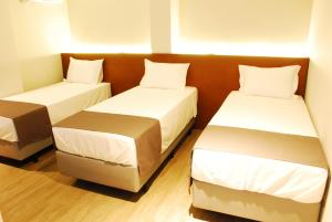 Cama ou camas em um quarto em Best Guest Hotel Expo Anhembi