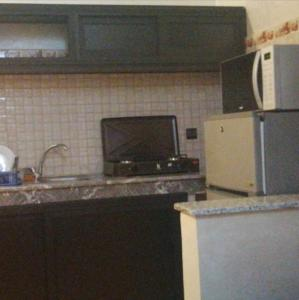 A kitchen or kitchenette at Residence Keltouma