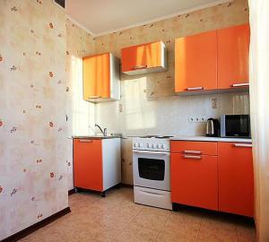 A kitchen or kitchenette at ApartLux Ostankinskaya