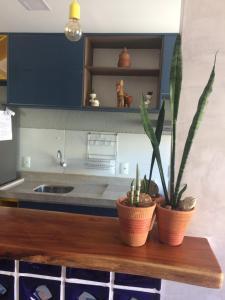 A kitchen or kitchenette at Conforto - VOG Torres do Sul Ilhéus
