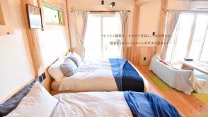 Southern Lights Club Yukurunyaにあるベッド