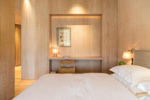 A bed or beds in a room at The Margi