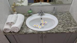 A bathroom at Lharmonie Villa