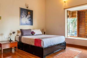 A bed or beds in a room at Firefly Homestay by Vista Rooms