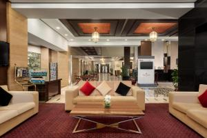 The lobby or reception area at Ramada by Wyndham Islamabad