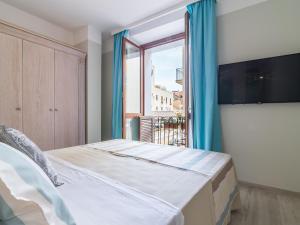 Ein Bett oder Betten in einem Zimmer der Unterkunft L'Ambasciata Hotel de Charme