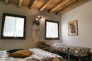 Letto o letti in una camera di LA LOGGETTA affittacamere