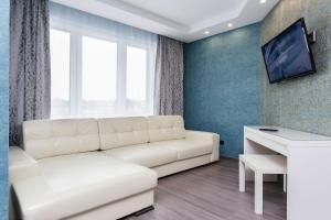 A seating area at Apartment Roomer 6