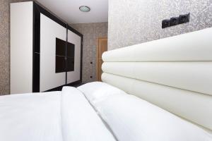 A bed or beds in a room at Apartment Roomer 6