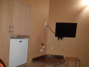 A television and/or entertainment center at Boutique Hotel Pavo
