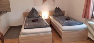 A bed or beds in a room at StudioApartments Haus Schneider
