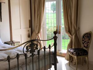 A bed or beds in a room at Retreat at The Knowe Auchincruive Estate