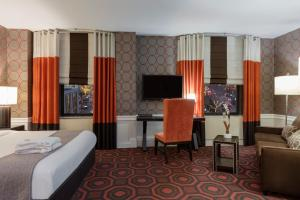 A television and/or entertainment center at Empire Hotel