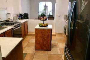 Una cocina o zona de cocina en Casa Del Sol