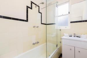 A bathroom at Live like a local, steps from Bondi Beach