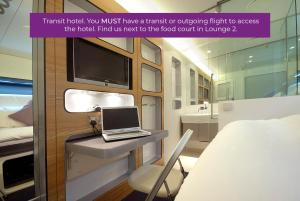 A television and/or entertainment center at YOTELAIR Amsterdam Schiphol Transit Hotel