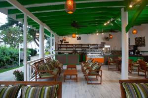 A restaurant or other place to eat at St. James's Club Morgan Bay Resort - All Inclusive