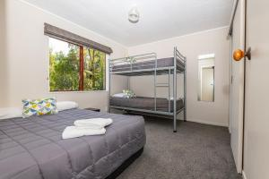 A bunk bed or bunk beds in a room at Blue Lake TOP 10 Holiday Park