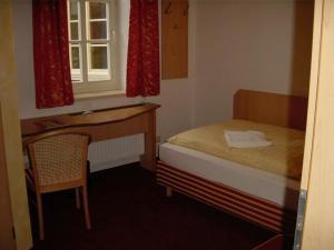 Ein Bett oder Betten in einem Zimmer der Unterkunft Hotel Weidenmühle