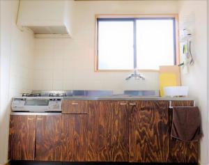 A kitchen or kitchenette at Yoshimura