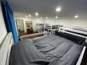 A bed or beds in a room at Happy Home Hostel