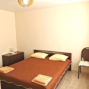 Кровать или кровати в номере Гостевой домик в СПА-Банном комплексе Лепота