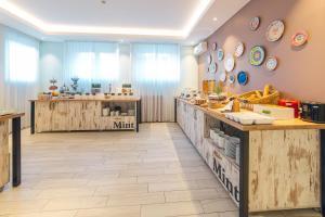 Küche/Küchenzeile in der Unterkunft Garni Hotel Mint