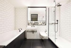 A bathroom at Andaz London Liverpool Street - a Concept by Hyatt