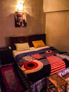 A bed or beds in a room at Earth House