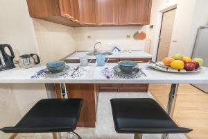 Кухня или мини-кухня в Calibri House